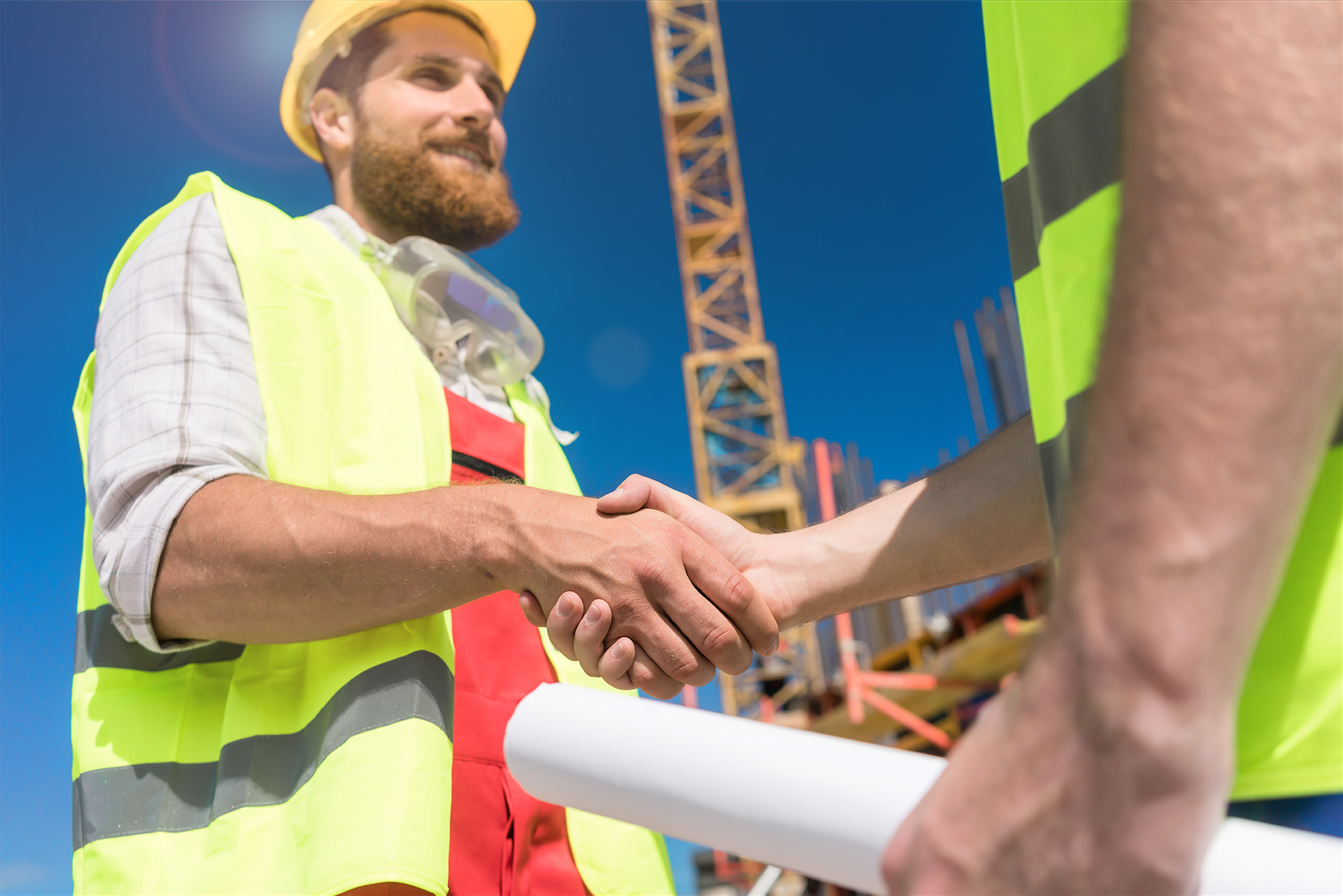 Cheerful worker shaking the hand of an architect at the beginning of a new project