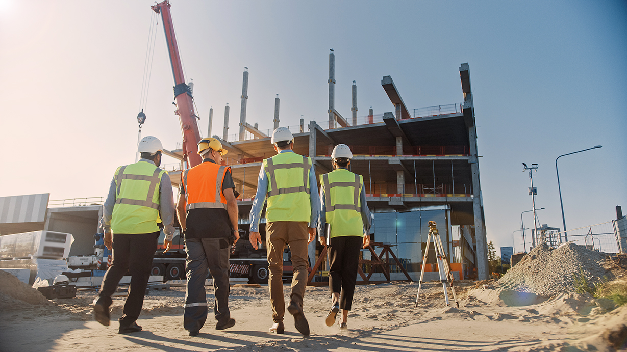 Diverse Team of Specialists Inspect Commercial, Industrial Build